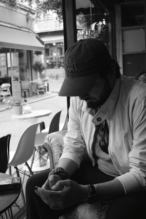 Young Adult Day Sitting People Cafe Shop Close-up People Portrait Casual Clothing People Photography The Portraitist - 2017 EyeEm Awards The Calm Photography Movement The Street Photographer - 2017 EyeEm Awards Photography Themes Hello World Indoors  Men Portrait Focus On Details My Model Bnw_collection My Man EyeEm Best Shots - Black + White Blackandwhite Monochrome Monochrome Photography