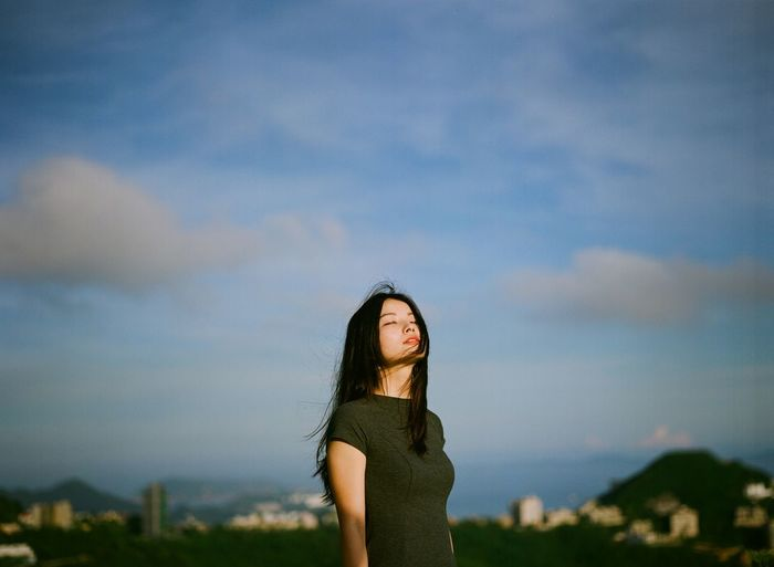 Silhouette of woman standing against sky
