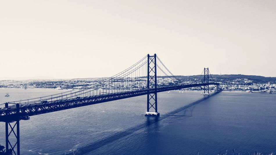 Bridge - Man Made Structure Sea Tranquility Silhouette Travel Destinations Outdoors Suspension Bridge Beach No People Sky Scenics Horizon Day Steel Horizon Over Water Architecture Beauty In Nature Clear Sky Technology Nature Building Exterior Architecture City