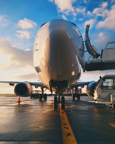 Airplane Airport Airport Runway Transportation Sky Travel Public Transportation Mode Of Transport Outdoors Commercial Airplane Air Vehicle Journey Passenger Boarding Bridge Cloud - Sky Day No People Runway