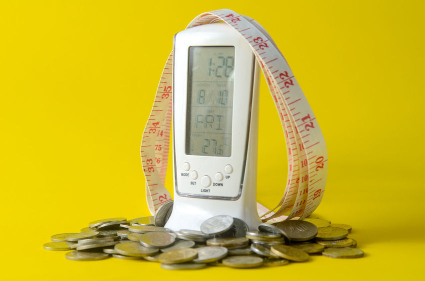 Accuracy Close-up Coin Colored Background Currency Economy Finance Indoors  Instrument Of Measurement Large Group Of Objects Metal No People Number Still Life Studio Shot Table Tape Measure Thermometer Yellow Yellow Background