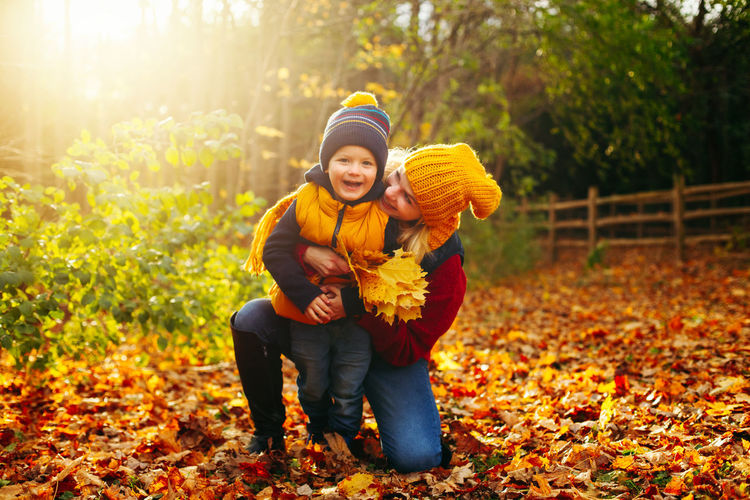 Smiling woman and son during autumn