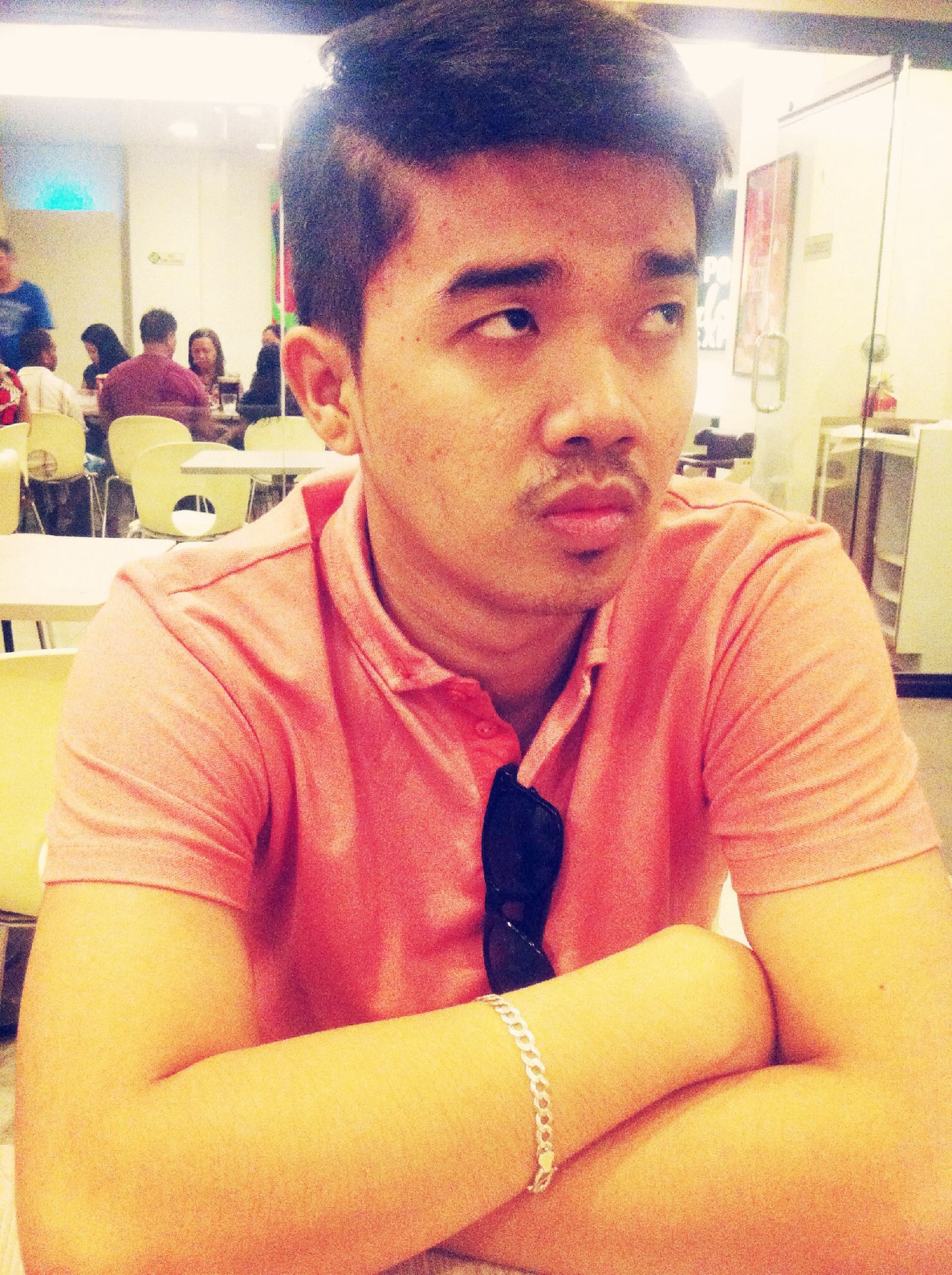 indoors, person, lifestyles, food and drink, casual clothing, front view, leisure activity, looking at camera, young adult, portrait, sitting, restaurant, waist up, food, young men, smiling, holding, headshot
