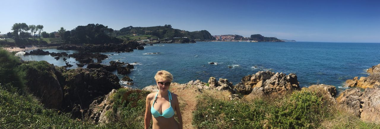 Sea Water Clear Sky Rear View Tranquil Scene Rock Formation Full Length Cliff Blue Beauty In Nature Tranquility Scenics Tourist Geology Tourism Coastline Nature Non-urban Scene Person Physical Geography One Person Asturias Perlora People And Places