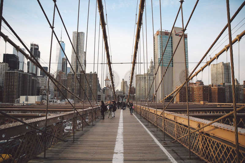 Architecture Architecture Bridge - Man Made Structure Brooklyn Bridge  Brooklyn Bridge / New York Built Structure City City Cityscape Connection Engineering Men New York New York City Outdoors People River Sky Sunset Suspension Bridge Transportation Travel Travel Destinations Water Winter
