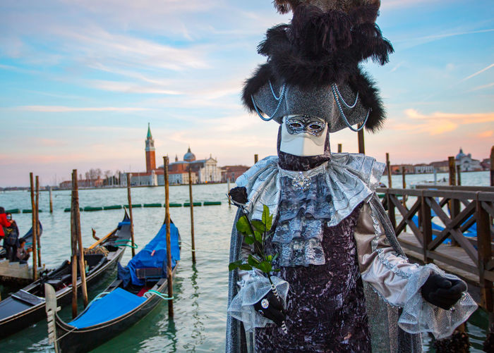Carnival Carnival In Venice Venice, Italy Architecture Building Exterior Built Structure Carnival Clothing Carnival Masks Day Gondola - Traditional Boat Mask - Disguise Nautical Vessel One Person Outdoors People Real People Sky Venetian Mask