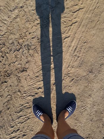 shadow, Low Section Standing Beach Sand Human Leg Shadow Directly Above Human Foot Foot