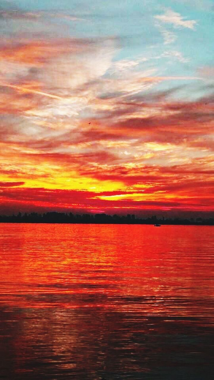 sunset, water, scenics, tranquil scene, orange color, tranquility, beauty in nature, waterfront, sky, reflection, idyllic, lake, cloud - sky, nature, rippled, dramatic sky, cloud, red, outdoors, sea