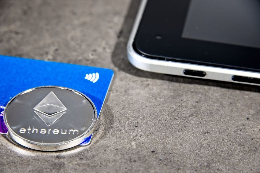 Shining silver metal ETH Ethereum coin, debit card and computer tablet BTC Gold Taxi Virtual Reality Bitcoin Blockchain Coin Communication Computer Equipment Crypto Cryptocurrency Cryptography Device Screen Digital Eth Ether Ethereum Exchange Finance Metal Screen Silver  Smart Phone Technology Wireless Technology