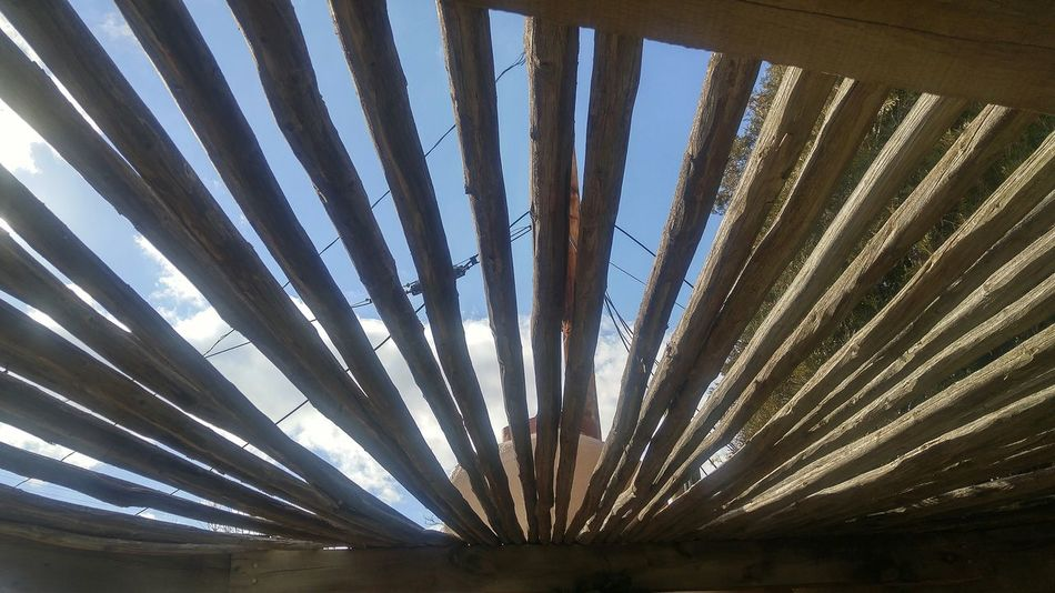 Pattern No People Outdoors Day Close-up Sky Nature Bars Sunny Looking Out The Window Urban Lifestyle Old Western Entrance Nature Urban Photography Urban Landscape Built Structure Backgrounds Filtered Image Filtered Light Window Roof Wooden Wood Wood - Material