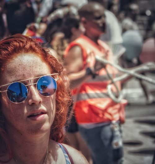 Sunglasses Real People Outdoors Redhead Focus On Foreground Portrait Leisure Activity Day Lifestyles One Person Close-up Adult People Where Am I? Street Vectors This Is Queer Arts Culture And Entertainment #FREIHEITBERLIN The Street Photographer - 2018 EyeEm Awards