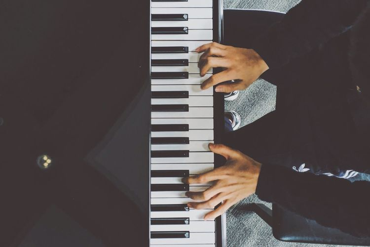 Low Section Of Man Playing Piano