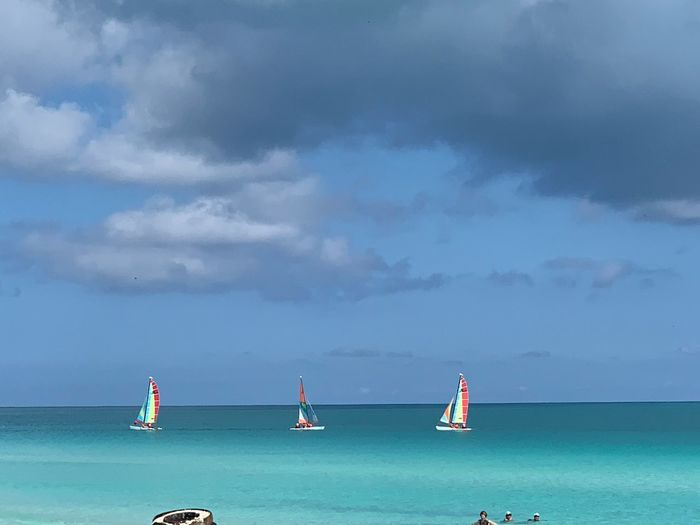 Water Cloud - Sky Sea Sky Nautical Vessel Transportation Horizon Over Water Horizon Nature Beauty In Nature Mode Of Transportation Scenics - Nature Travel Sailboat Beach Holiday Vacations Land Outdoors