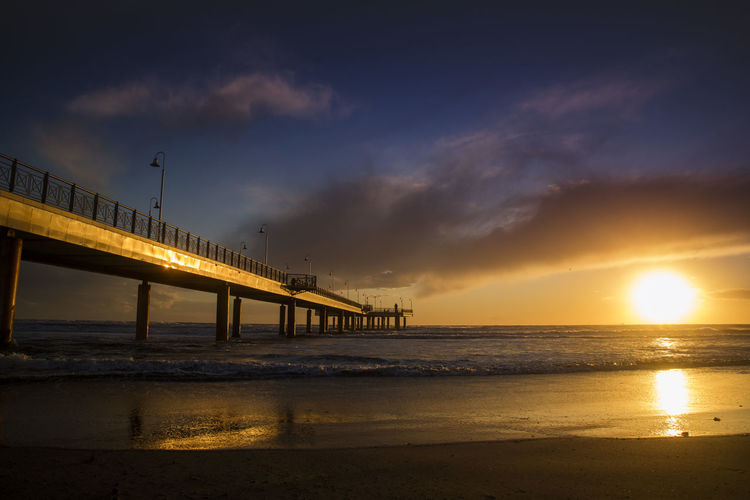 Water Sky Sunset Sea Cloud - Sky Built Structure Scenics - Nature Beauty In Nature Architecture Reflection Beach Land Nature Orange Color Connection Bridge Tranquility Tranquil Scene Bridge - Man Made Structure No People Sun Horizon Over Water Outdoors Architectural Column