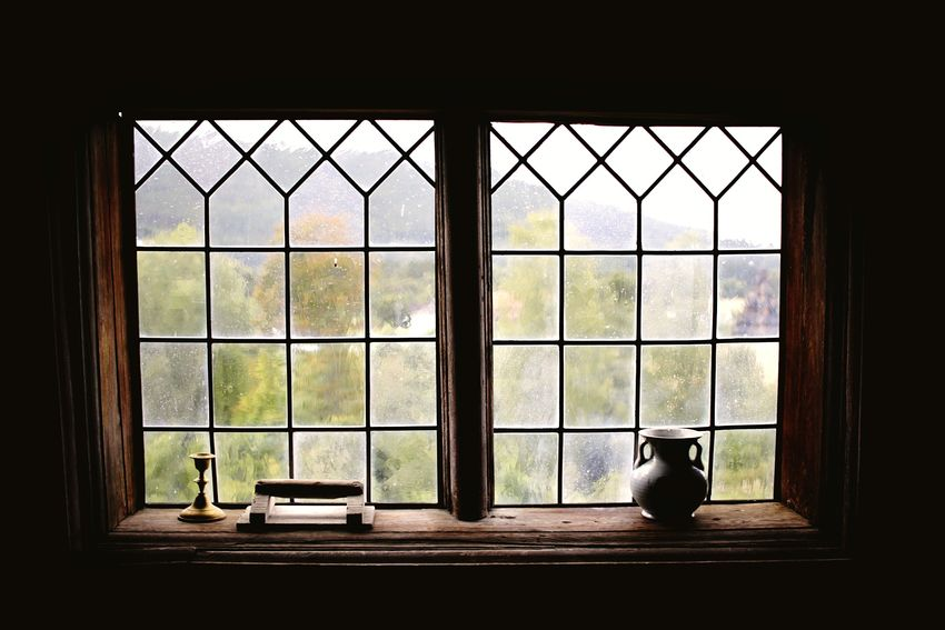 A wooden muntin window from the inside with a vase and a candle holder on the sill. Window Indoors  Looking Through Window Day No People Architecture Landscape Old House Old Buildings Europe Norway Norwegian Peace And Quiet Windowsill Candle Holder Candle Stand Vase Muntin Windows Wooden Window
