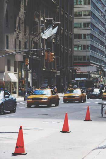 Manhattan City Architecture Building Exterior Built Structure Street Transportation Car Mode Of Transportation Motor Vehicle Road Building City Street City Life Land Vehicle Sign Day Office Building Exterior Cone Incidental People Nature