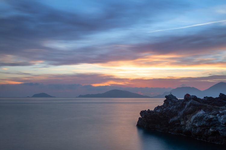 Tellaro, Golfo dei Poeti, Liguria Water Scenics - Nature Sky Beauty In Nature Cloud - Sky Sunset Tranquility Sea Idyllic Mountain Non-urban Scene Rock Formation Rock - Object Rock No People Nature Golfodeipoeti Golfo Dei Poeti Liguria La Spezia Tellaro Sunset #sun #clouds #skylovers #sky #nature #beautifulinnature #naturalbeauty #photography #landscape EyeEm Best Shots EyeEm Nature Lover EyeEm Selects