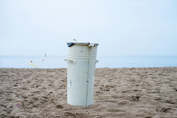 Garbage Bin At Beach Against Clear Sky