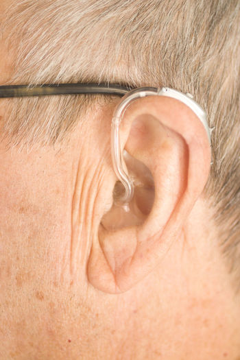 Hearing Aid Ear Deaf Health Aids Sound Device Audiology Isolated Medical Medicine Deafness Technology Care Background Disabled Digital Healthcare Instrument Hear Equipment Closeup Accessory Audiologist Disability  Loss Close-up Listen Auditory Help Modern Man Caucasian Old Aged White Gray Hair