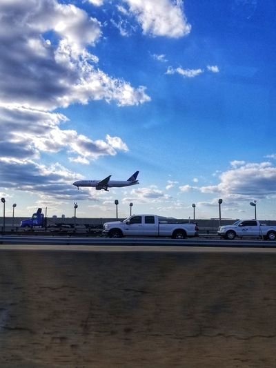 """""""Let's race!"""" AndroidPhotography Drivebyphotography No People Cloud - Sky Planes Trains And Automobiles Trucks Highway Cars Vehicles Airport"""