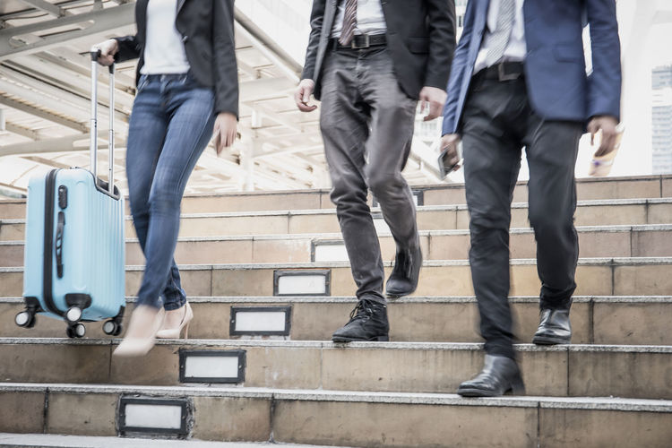 Adult Architecture Blurred Motion Body Part Clothing Coworker Day Group Of People Human Leg Low Section Men Motion on the move Outdoors People Real People Shoe Staircase Steps And Staircases Walking Well-dressed Women
