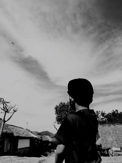 A boy with a kite, Bali. Taking Photos People Watching Kite Clouds And Sky Boy Enjoying Life Cool