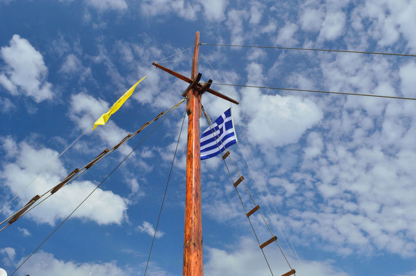 Greece flag in front of the blue sky Blue Cloud - Sky Day Flag Greece Flag Low Angle View Nature No People Patriotism Sky Wind Power