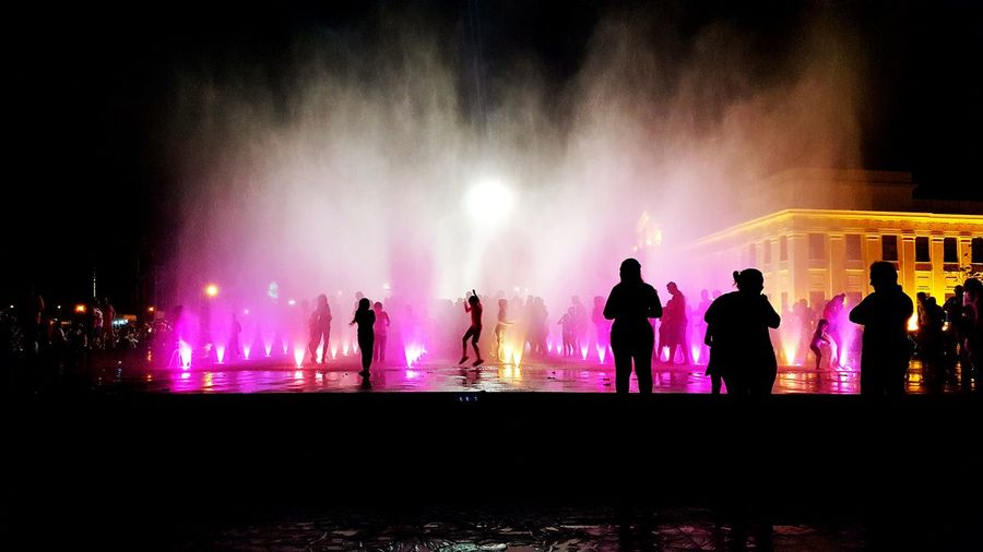 Managua Night Illuminated Silhouette Standing Large Group Of People Lifestyles Arts Culture And Entertainment Men Leisure Activity Performance Fountain Person Enjoyment Nightlife Outline Concert Outdoors Sky Crowd Event Nicaragua Nicaraguan Happiness ♡ People And Places