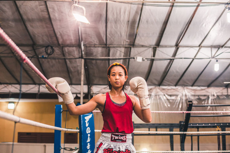 Ready. International Women's Day 2019 Real People Lifestyles Front View Sport Women Healthy Lifestyle Exercising Strength Waist Up One Person Young Adult Sportswoman Young Woman Woman Muay Thai Fight Portrait