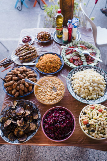 Kebabs in Morocco Morocco Agadir Africa Authentic Moments Travel Food Food And Drink Freshness Bowl Variation Choice Healthy Eating High Angle View Wellbeing Table Focus On Foreground Large Group Of Objects Abundance Plate Still Life No People Day Ready-to-eat Fruit Close-up Kebab Meeting Chicken Cuisine