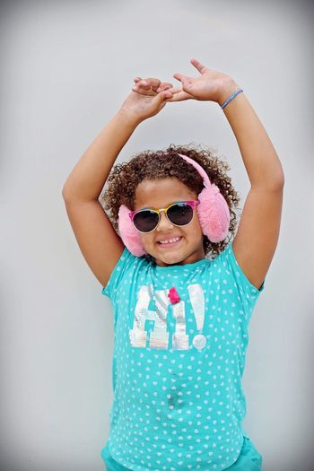 Dancing Dance Dancing Childhood Child One Person Indoors  Front View Girls Real People Smiling Lifestyles Leisure Activity Innocence Females White Background Wall - Building Feature Women Human Arm Arms Raised Cute Fashion Clothing