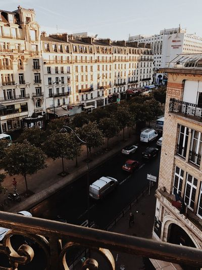 View of street Balcony Balcony View View Of Paris View Of The Town View Of The City Architecture Building Exterior Built Structure Mode Of Transport Land Vehicle Transportation Car Day Outdoors Road City Sky No People