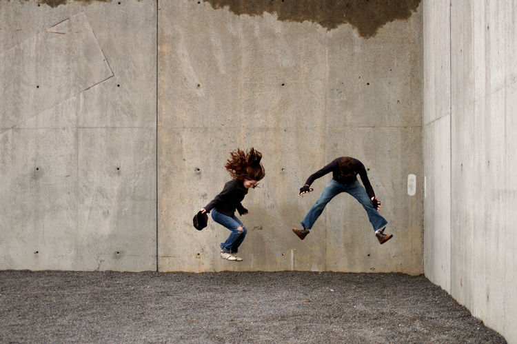 Concrete Day Grey Wall Jump Jumping Jumping Shot Man Millenials Outdoors People Woman