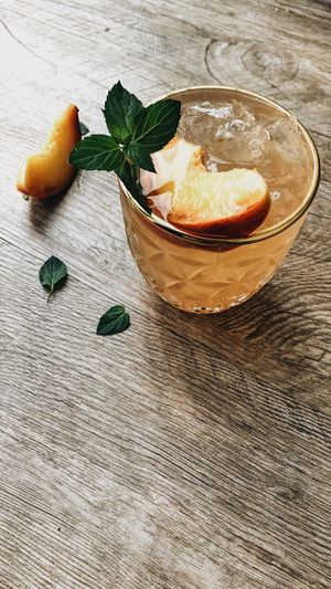 ice cold peach ice tea Cocktail Hour Healthy Lifestyle Vegan Peach Ice Tea Peach Ice Tea Cool Drink Cold Drink Refreshment Peppermint Food Decoration Drinking Glass Drinks Summer Vibes Summer Drink Food Food And Drink Freshness Fruit Healthy Eating Indoors  No People Still Life Sweet Food Wellbeing Citrus Fruit Orange Color Dessert Leaf
