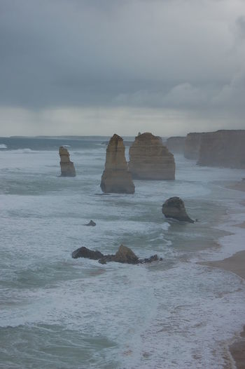 Stormy day at the 12 Apostles. Victoria. Australia Water Sea Sky Rock Beauty In Nature Scenics - Nature Rock - Object Solid Tranquility Tranquil Scene Rock Formation Cloud - Sky Nature Waterfront No People Land Idyllic Horizon Over Water Horizon Outdoors Stack Rock Eroded 12 Apostles Australia Victoria