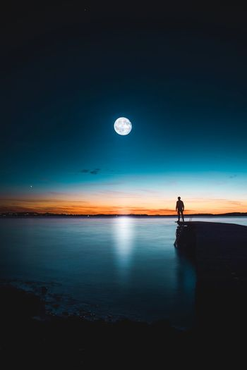EyeEm Selects Water Moon Sky Sea Night Beauty In Nature Nature Scenics - Nature Full Moon Tranquility Space Tranquil Scene Astronomy Reflection Beach One Person Horizon Over Water Land Outdoors Planetary Moon