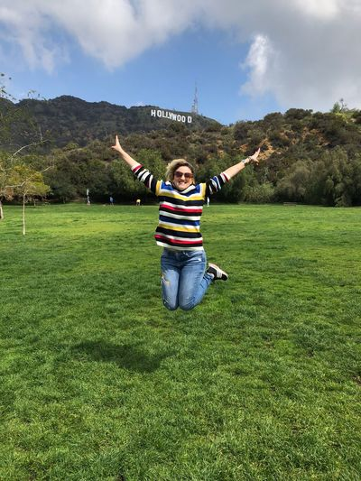Hollywood Today's Hot Look Trip Celebration Jump California California Dreamin Vacations Hollywood Grass Casual Clothing Sky Day Happiness Growth Leisure Activity Smiling Nature Full Length Outdoors Enjoyment Green Color