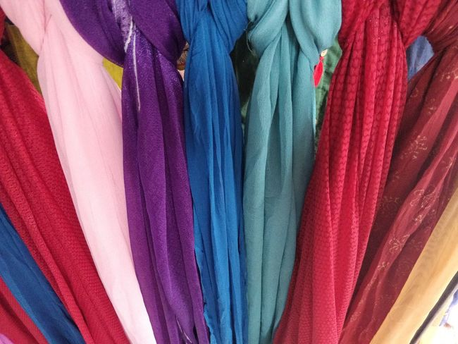 Multi Colored Choice Variation Textile Retail  Full Frame For Sale Backgrounds No People Clothing Market Still Life Store Hanging Side By Side Indoors  Collection Close-up Clothing Store Shopping Retail Display Consumerism Scarf Garment