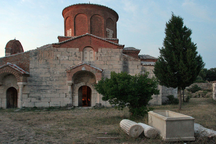 Orthodox monastery of Apollonia at sunset Albania Apollonia Ortodoxmonastery Architecture Building Exterior Built Structure Columns Cross History Nature No People Ortodox Church Ortodox Religion Outdoors Place Of Worship Religion Sarcophagus Spirituality Sunset Tree