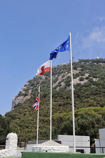 The flags on Gibraltar, the United Kingdom and the E.U flying on the Rock of Gibraltar Blue Brexit British Clear Sky Clear Sky And Flags E.U Flag E.U. Flag Flag Pole Flags Flags And Sky Flags In The Wind  Gibraltar Gibraltar Flag Gibraltar Flag And Union Jack Gibraltar Landscape Gibraltar Rock Low Angle View Patriotism Rock Of Gibraltar Union Jack Union Jack Flag Union Jack Flags Against Sky Union Jack, Gibraltar And E.U Flags Waving