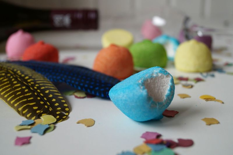 Close-up of multi colored balls on table