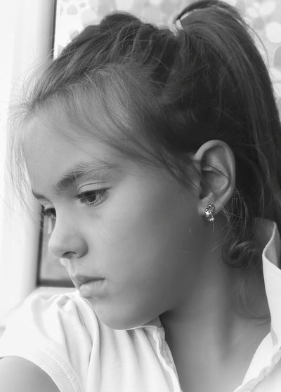 Close-Up Of Girl Looking Away At Home