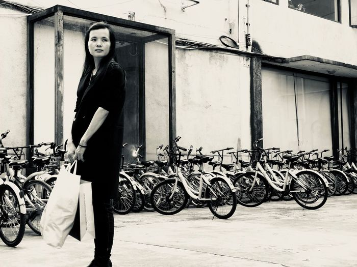 One Person Bicycle Real People Full Length Young Adult Standing Young Women Outdoors Built Structure Looking At Camera Lifestyles Building Exterior Women Day Portrait Architecture Adult Adults Only People IPhoneography
