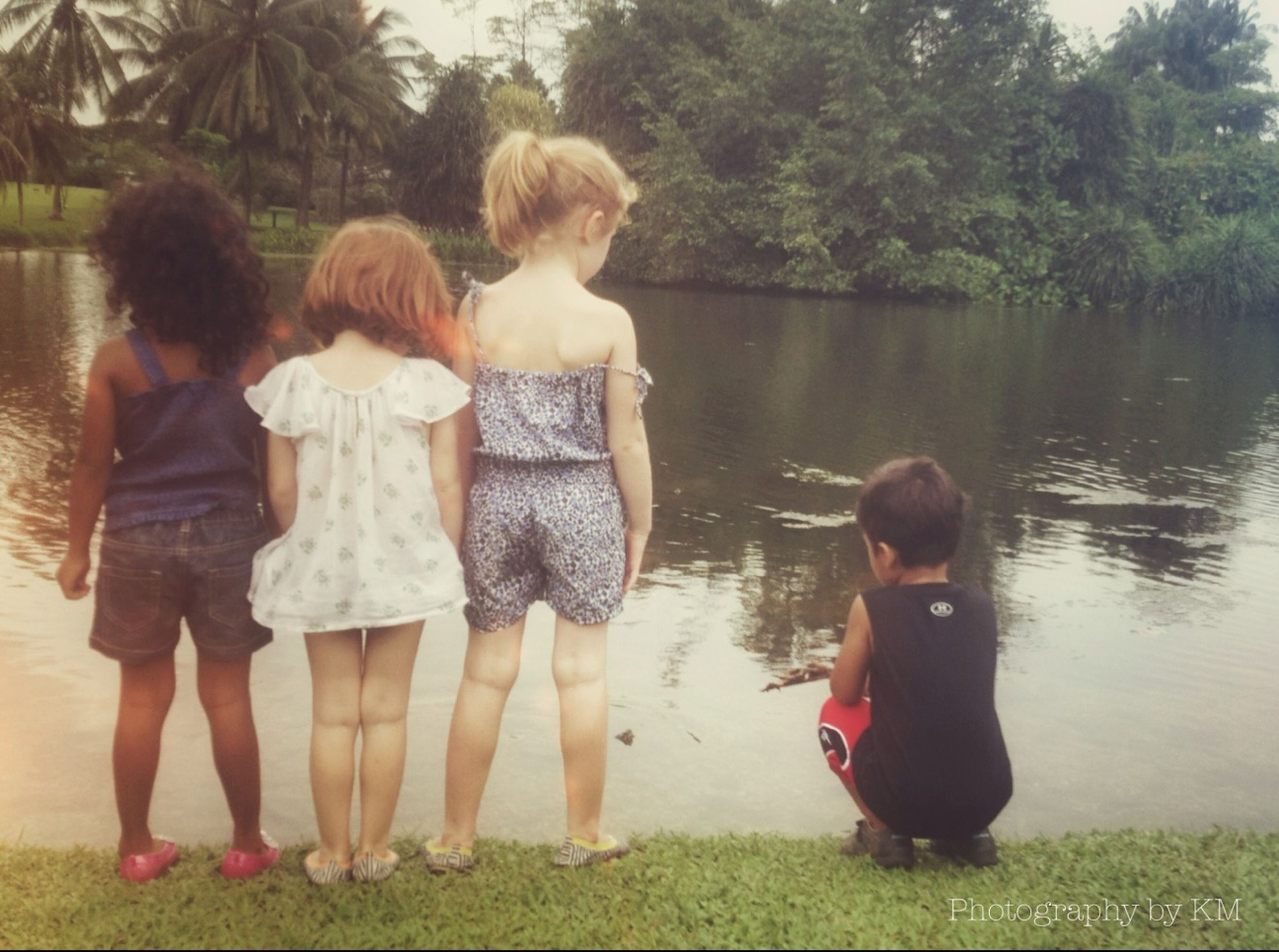 childhood, togetherness, elementary age, water, casual clothing, lifestyles, bonding, leisure activity, girls, full length, love, person, boys, family, innocence, cute, brother, sibling