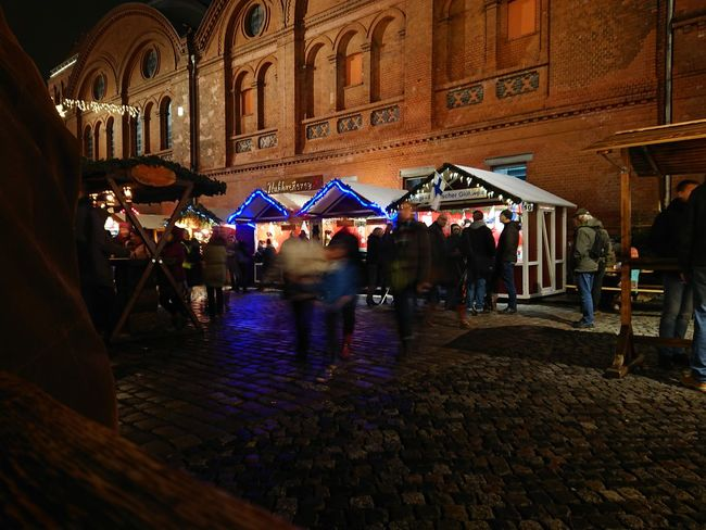 People visiting a Christmas market Christmas Market Stand Christmas Markets Crowd Group Of People Illuminated Leisure Activity Night North Europe Outdoors People Real People