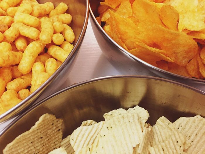 High angle view of snacks in bowls on table