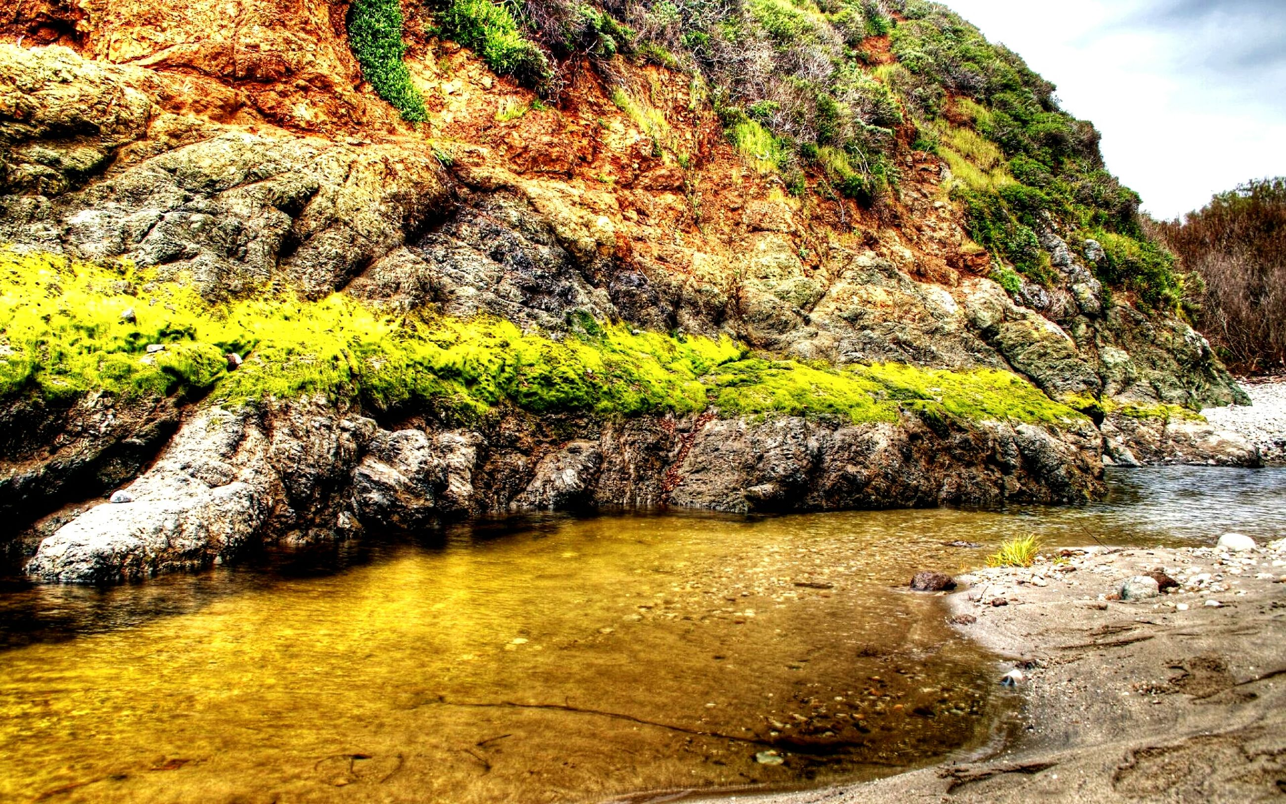 water, rock - object, nature, beauty in nature, tranquility, tranquil scene, scenics, rock formation, growth, plant, rock, river, tree, day, sky, outdoors, stream, grass, cliff, non-urban scene