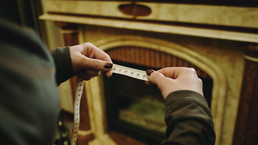 Measuring tape centimeter Measure Measurement Measuring Tape Centimeter Roulette Hands Woman Inch Real People Human Hand Holding Indoors  Human Body Part One Person Men Close-up Day