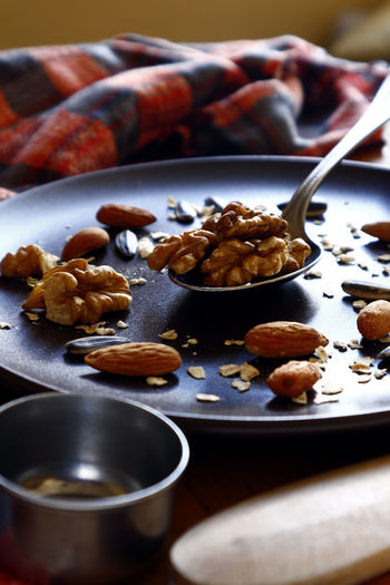 walnut, almond nuts and sunflower seeds on a plate Food Food And Drink Snack Time! Snacks! Flavor Taste Ingredient Spoon Plate Table Kitchen Utensils Comfort Food Nut - Food Dessert Almond Walnut Sunflower Seed Chestnut - Food Nutshell