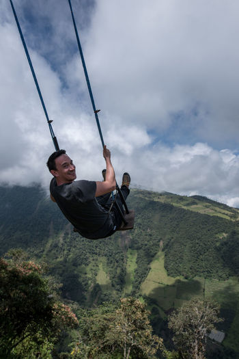 It is a very unique experience to swing over the deep gap in front of casa del Arbol, cool and worth doing it for all that feel their adeventure while traveling Baños Casa Del árbol Ecuador Feel The Journey Landscape Leisure Activity Lifestyles Man Mountain Range Mountains Nature Nature Original Experiences Outdoors People People Photography Portrait Swing Vacations Natural Light Portrait On The Way Finding New Frontiers An Eye For Travel